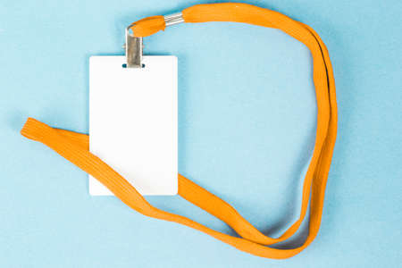 Empty ID card  icon with an orange belt, on a blue background. Space for text.
