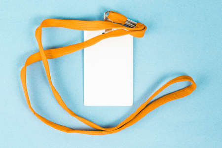 Empty ID card / icon with an orange belt, on a blue background. Space for text. Stockfoto