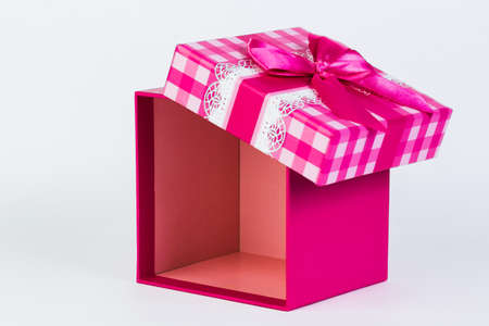 beautiful gift box with a bow on a white background. Stock Photo