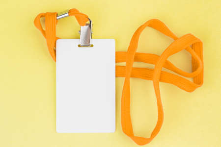 Blank card ID  icon with an orange belt on a yellow background. Space for text.