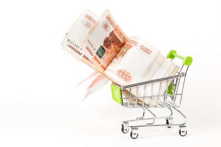 Food trolley, full of Russian 5000 banknotes. On a white background