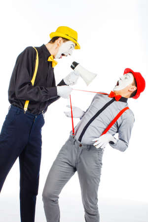 Two clown, MIME, flashy Megaphone. The expression of emotions. On a white background.