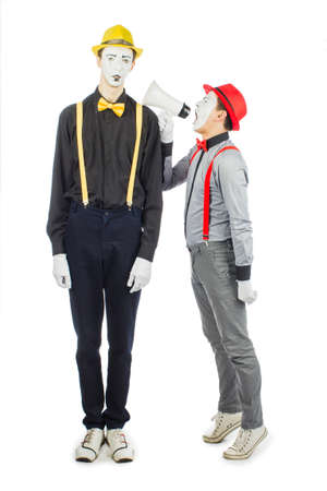 Two clown, MIME, flashy Megaphone. The expression of emotions. Isolated on white background.
