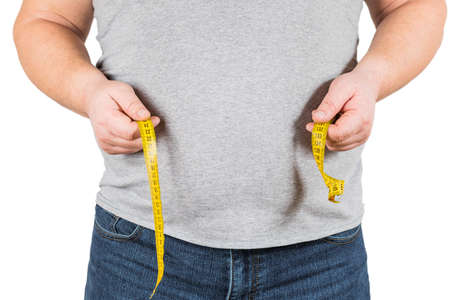 Thick mature man measuring belly yellow measuring tape isolated on white background
