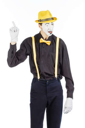 Portrait of a man, artist, clown, MIME. shows something. isolated on white background.