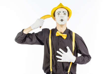 Portrait of the MIME in the form of a criminal, gangster. Race bandit. Keep a banana at hand in the form of weapons .  on white background.