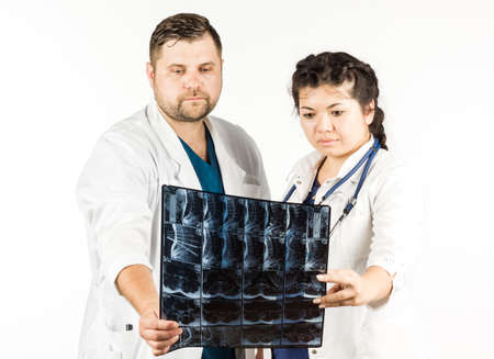 healthcare and medical concept, doctor and student looking at an x-ray. on a white background. Stock Photo