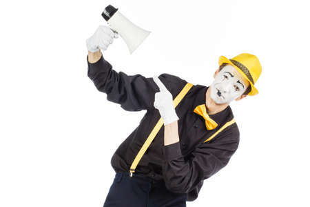 Portrait of a male mime artist, shouting or showing on a megaphone. Isolated on white background. Zdjęcie Seryjne