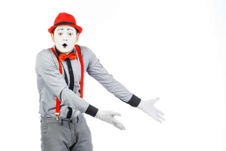 Portrait of a man, artist,clown, MIME. Shows something, isolated on white background Zdjęcie Seryjne