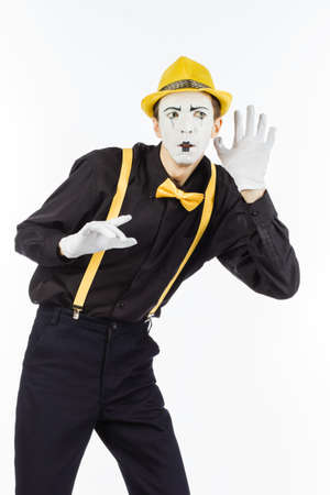 Man, Arist, MIME holding hand near ear and listened. the expression of human emotions and the concept of lifestyle. images on white Studio background.