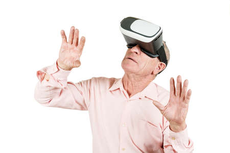 Grandfather is looking at the VR sunglasses, gestures with his hands, isolated on a white background Stock Photo