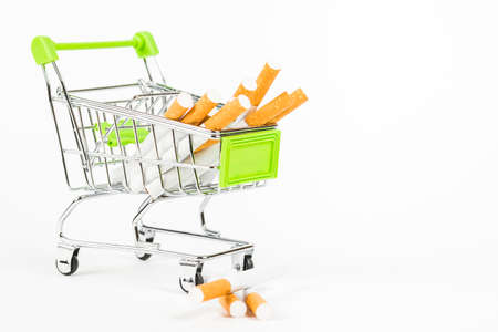 food basket with cigarettes on white background Stock Photo