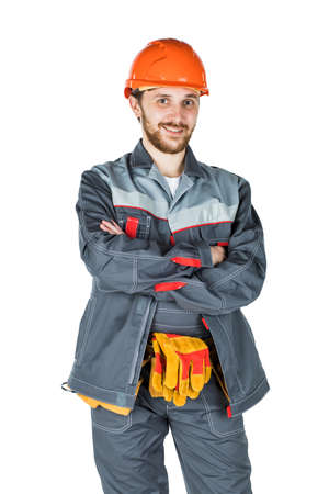 Smiling young builder, looking at camera. Repair and construction. Isolated over white background Stockfoto
