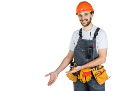 The man builder shows something. Isolated over white background 写真素材