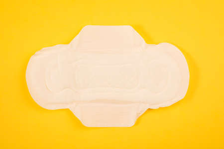 Sanitary pads and tampon on a yellow background. hygiene products. Stock Photo