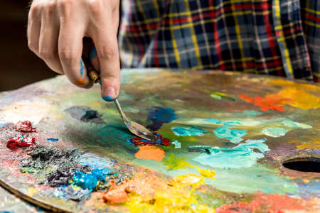 Art painting with palette knife. hand of the artist.