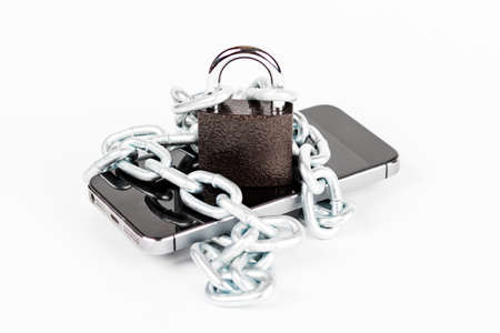 Smartphone with chain and lock locked on white background, security concept and pirate network.