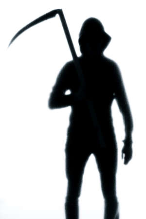 Dangerous man behind frosted glass with a scythe in his hand. Halloween. Black and white image