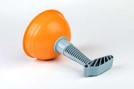 Plunger (plunger) orange for cleaning toilet on white background