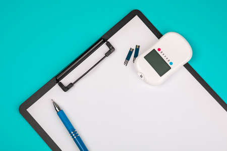 Document, record data from glucometers to medical forms, the result of the sugar measurement, concept of measurement of blood sugar. On a blue background.