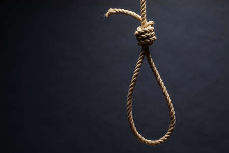Noose. The concept of murder or suicide. On dark background.