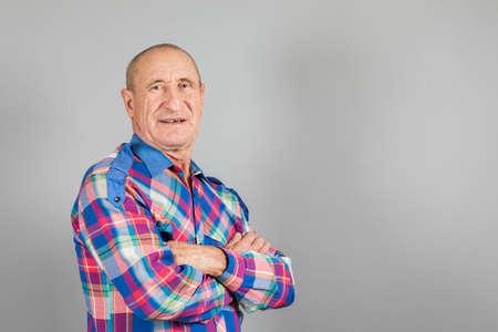 Smiling happy old man portrait on neutral grey background Standard-Bild - 118147770