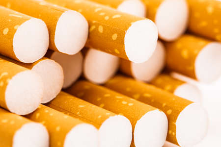 Cigarettes in a pack closeup on white background. Smoking tobacco. Bad habit. Stock Photo