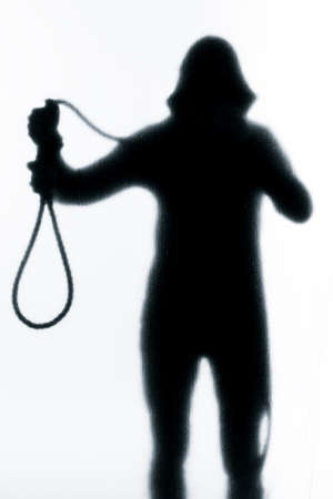 Dangerous man behind frosted glass with a noose around his neck or in his hand. Halloween. Black and white image