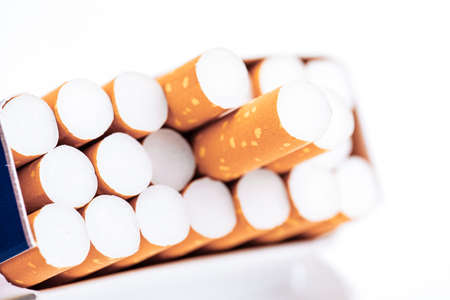Cigarettes in a pack closeup on white background. Smoking tobacco. Bad habit. Stock Photo - 120197015