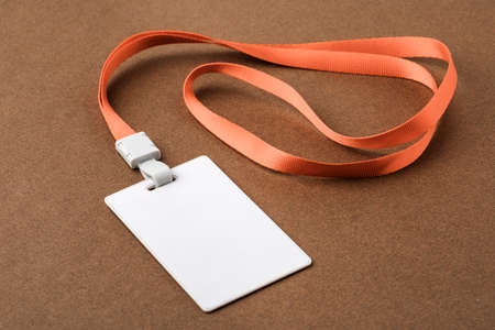 Empty security tag on brown background. Place for text, layout