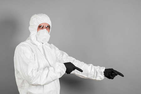 A medical scientist or a police officer in riot gear pointing to an empty space. The concept of health and crime