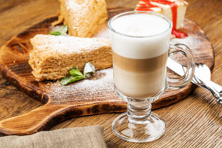 A glass of delicious latte on wooden table
