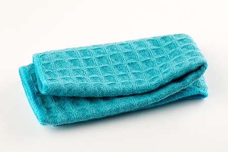 Clean blue kitchen towel on white background