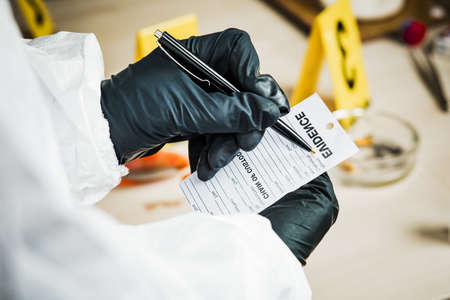Forensic expert records data in the form of evidence. The concept of the crime