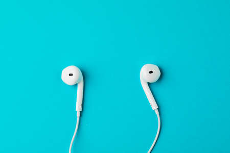Headphones on blue background. The concept of music Stock Photo