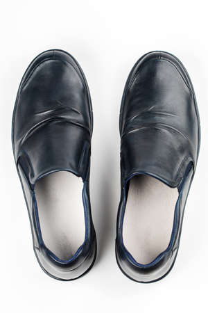 Blue mens shoes on a white background. 版權商用圖片