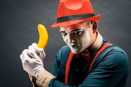 Portrait of MIM in the form of a criminal, a bandit. Race of bandits. Keep the banana in the form of weapons . Stock Photo
