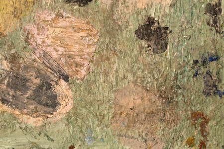 Background image of bright oil-paint palette closeup