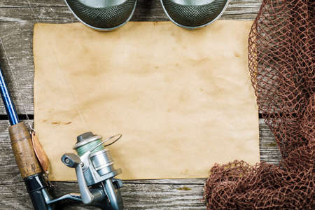 Fishing gear, hooks and baits on a wooden background. Stok Fotoğraf