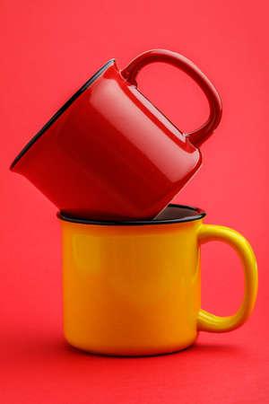 iron mug, on red background Stock Photo