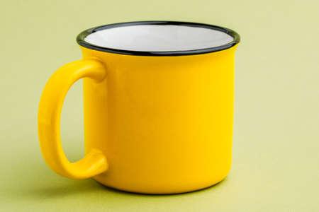 iron mug, on a green background Archivio Fotografico - 138044259