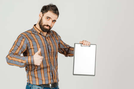 Portrait of an Arab man holding a white blank panel with space for text. On white background..