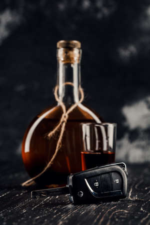 Bottle of wine with car keys concept for drinking and driving.