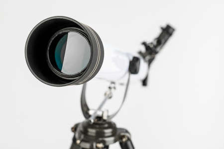 white telescope on tripod isolated on white background