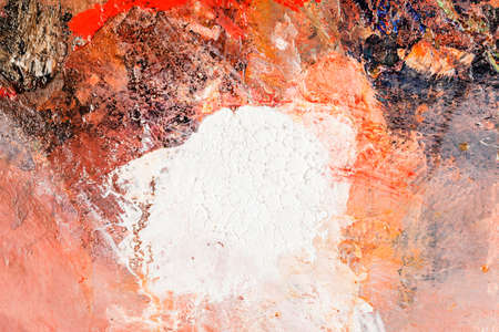 Background image of bright oil-paint palette closeup