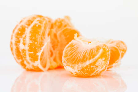 peeled tangerine isolated on white background.