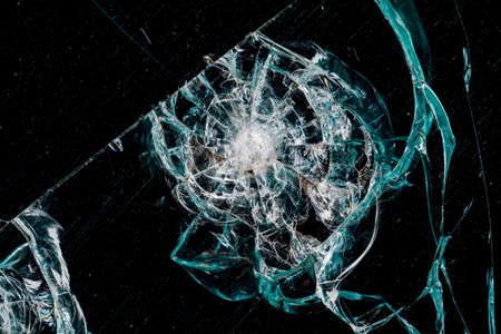 Cracks in car glass on a black background Stock fotó