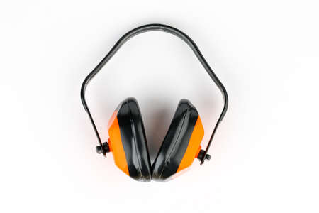 Protective orange headphones on a white background. Professional construction accessory Zdjęcie Seryjne