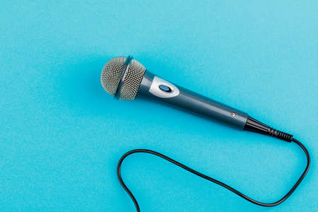 Vocal audio microphone on a blue background