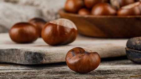 Chestnuts on an old wooden table.